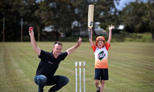 Tim Middlemas (7), of South Perth, with Autism in Cricket project officer Scott Henry at the Wembley Districts Junior Cricket Club grounds. Photo: David Baylis
