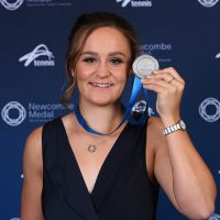 Ashleigh Barty poses with her medal after being awarded the 2019 Newcombe Medal. Picture: Quinn Rooney/Getty Images