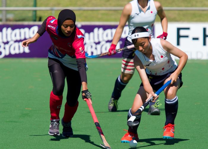 Fierce competition between the visiting Japanese and Kuala Lumpur teams in the Under 16 girls FHE Cup final, resulting in a shootout victory to Japan. Picture:John Whittingham