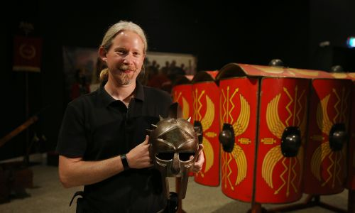 d497121d Exhibition curator Thomas Rizzo with a gladiator helmet. Picture: Andrew Ritchie