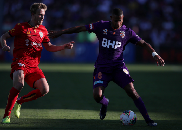 James Meredith of Perth Glory holds off Ben Halloran of Adelaide United. Picture: AAP Image/Gary Day