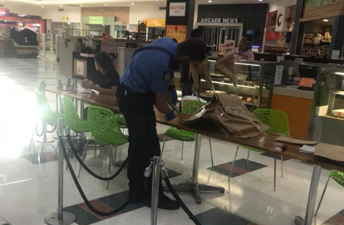 A shopping centre security guard was taken to hospital.