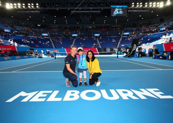 Manaka Kuni (6), of Tuart Hill, at Rod Laver Arena with Alicia Molik and ANZ representative Sweta Mehra.