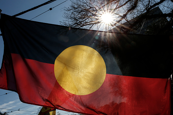 The Indigenous Flag is seen flying during a NAIDOC March. Picture: Darrian Traynor/Getty Images