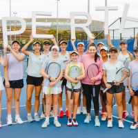 Casey Dellacqua with tennis coaching clinic participants. Picture: Damo Photography