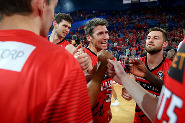 Damian Martin of the Perth Wildcats celebrates with his team mates after a win. Picture: James Worsfold/Getty Images