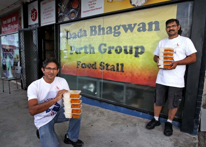 Volunteer Hiten Shah from Dada Bhagwan Perth Parivar and Amba Foods WA owner Bhavin Desai with some of the free meals. Picture: David Baylis d498601