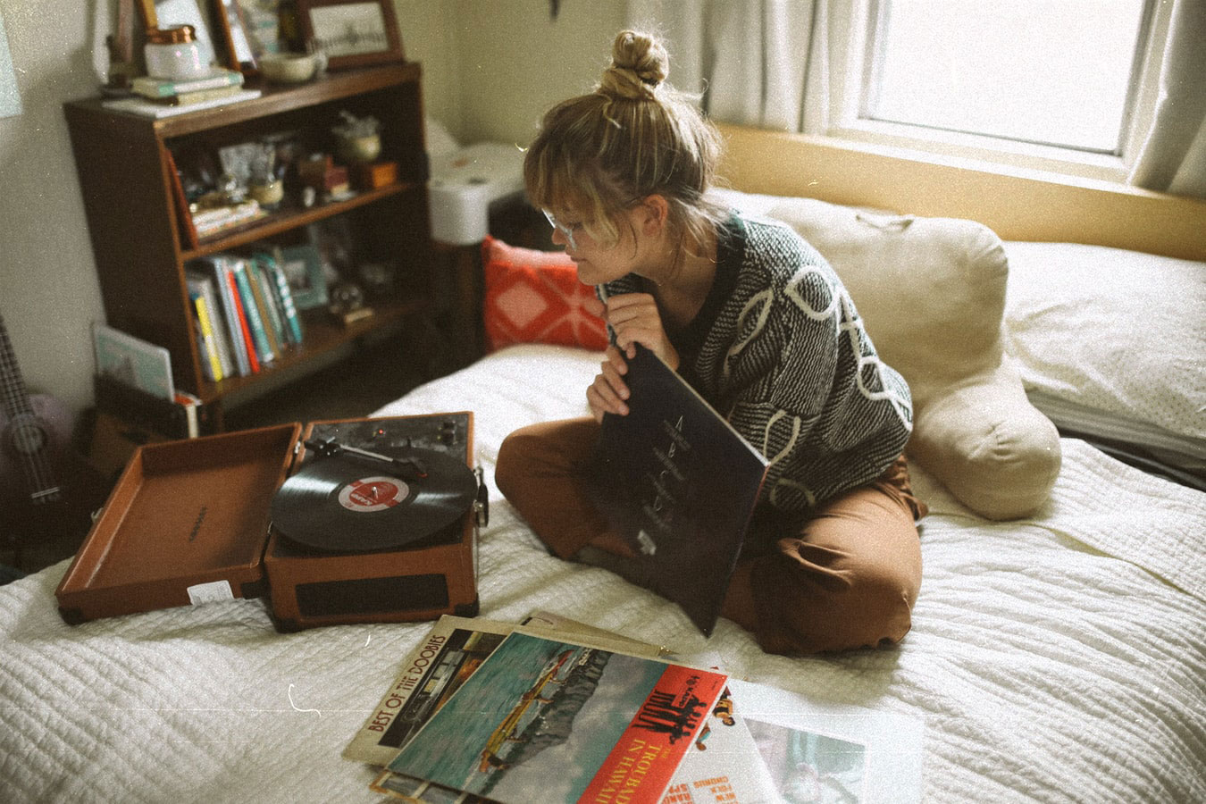 photo of a girl in her room listening to a record player | by aerosphotos @ unsplash.com