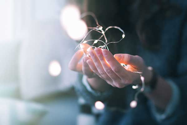 fairy lights in palm of hand