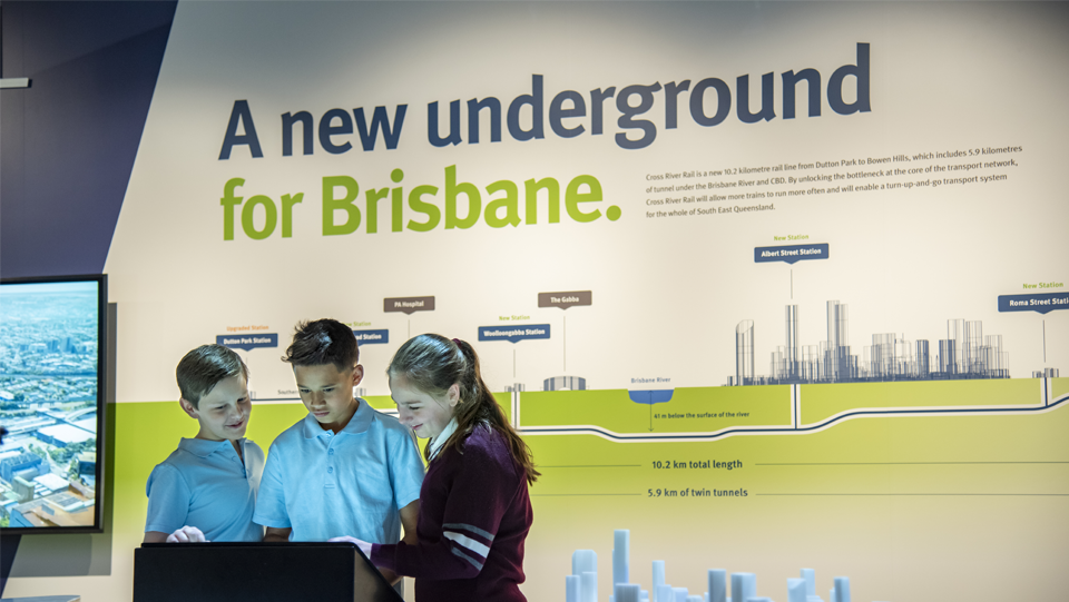 School students use interactive screens to learn about the Cross River Rail project