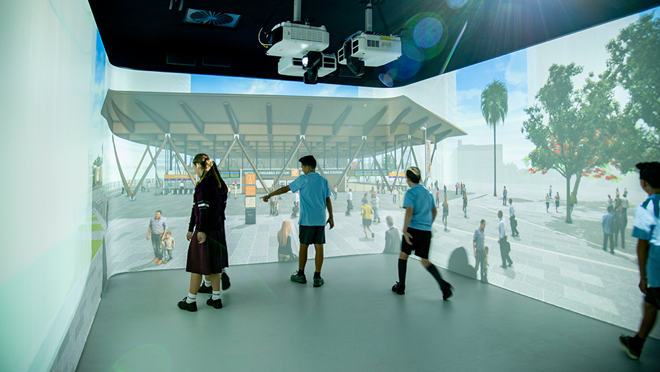 a group of school students exploring the new Woolloongabba station in the Reality Theatre