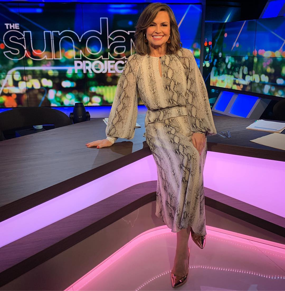 Australian television hosts proudly wear Cue!
