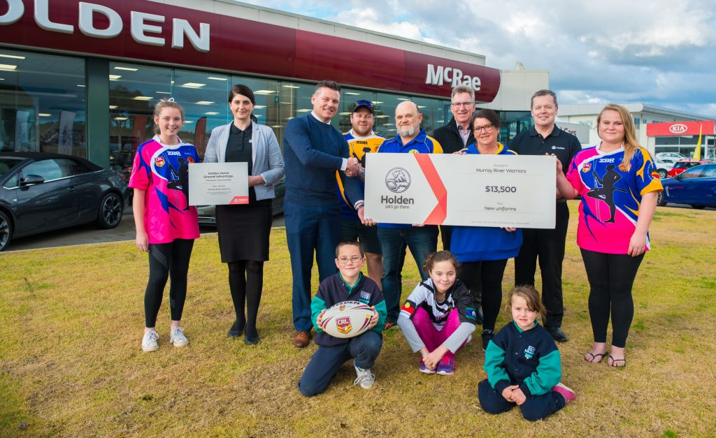 Players, Holden & McRae Motors representatives and AlburyCity Mayor Kevin Mack join the cheque handover celebrations.