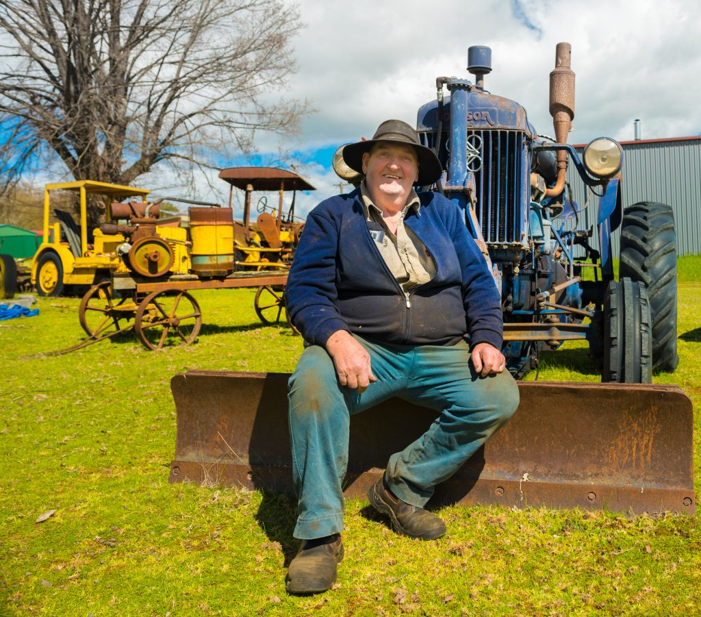 Bruce 'Trig' Tregilgas at home among some of his historic tractors.
