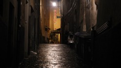 PERUGIA, ITALY - DECEMBER 04: A hotel is seen up a dark alley in the medieval walled hill-town of Perugia as night falls on December 4, 2009 in Perugia, Italy. The town is the capital of central Italy's Umbria region and has many preserved historic buildings and frescos.  (Photo by Oli Scarff/Getty Images)