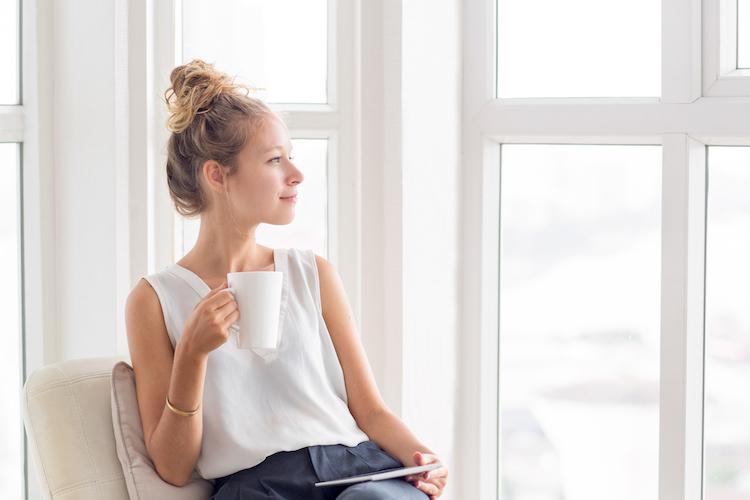 woman thinking when refinancing home loan