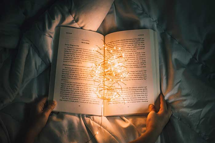 photo of book & lights by californong @ unsplash.com