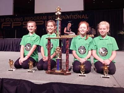 Hukerenui School R.U.R.A.L team with their trophies at the International Future Problem Solving Finals in Iowa, USA. Jasmine Hayes, Katie Barnes, Eliza Rockell, Makenna Purvis.