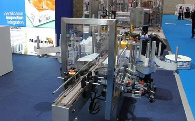 Compact inline labellers