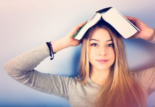 Girl balancing book on her head