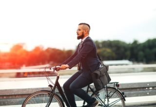 Man in suit cycling to work