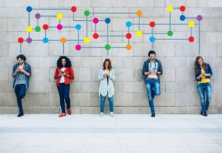 People standing under colourful networking image