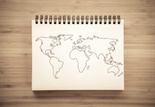 World map outline sketched on notebook