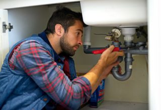 Plumber fixing kitchen sink