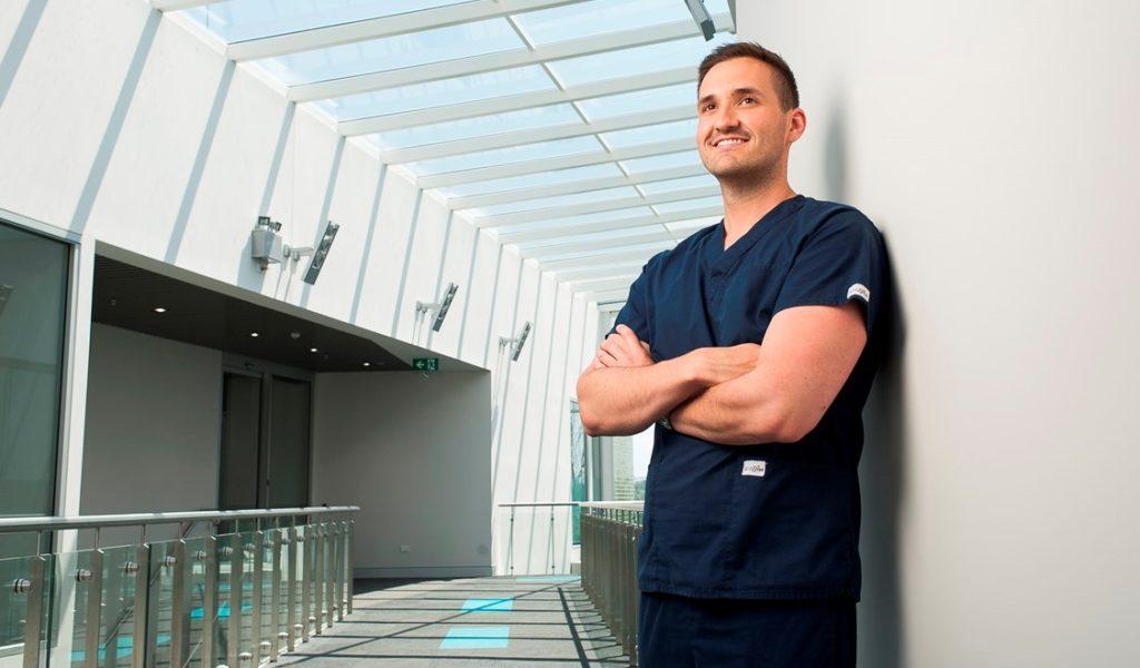 Male nurse standing in hospital
