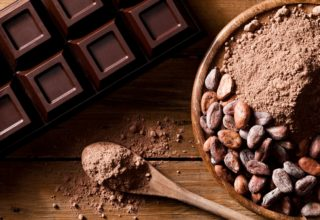 Chocolate bar, cocoa beans and wooden spoon