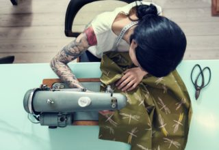 Birdseye view of woman working in fashion using sewing machine