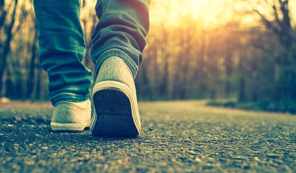 feet walking on road