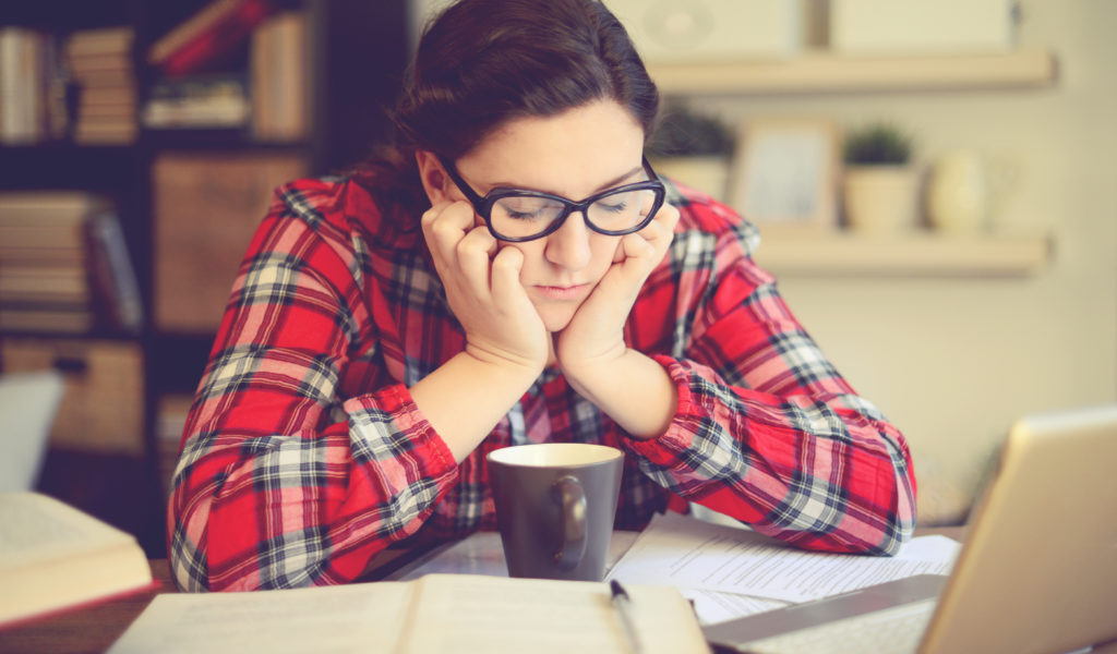 Signs you need to change course - stressed student at desk