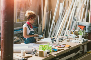 Latina Carpenter Standing In Her Workshop