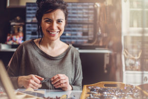 Beautiful woman jewelry maker