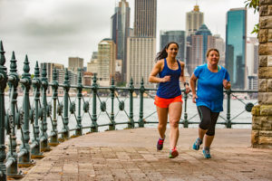 Woman and Personal Trainer Running by Sydney Harbour