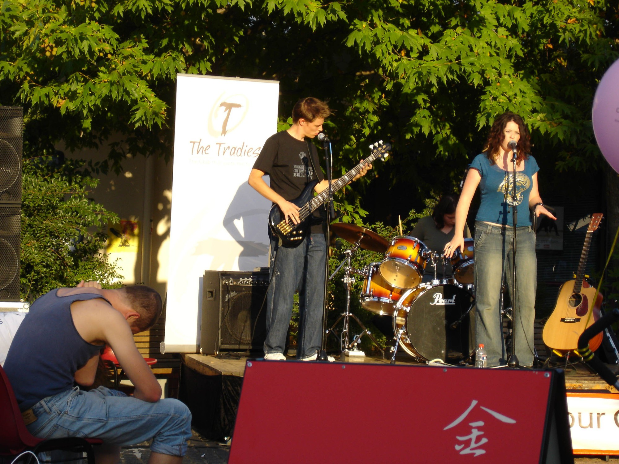 Jack playing guitar on stage with one of his rrock bands.