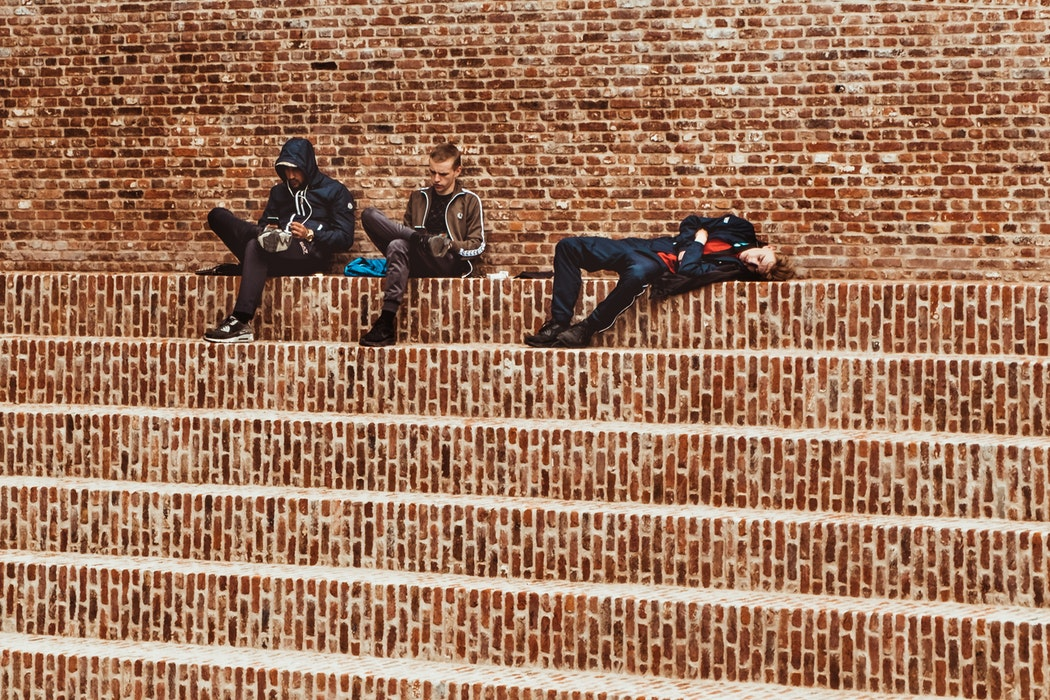 teens sitting on steps image source: by miteneva @ unsplash