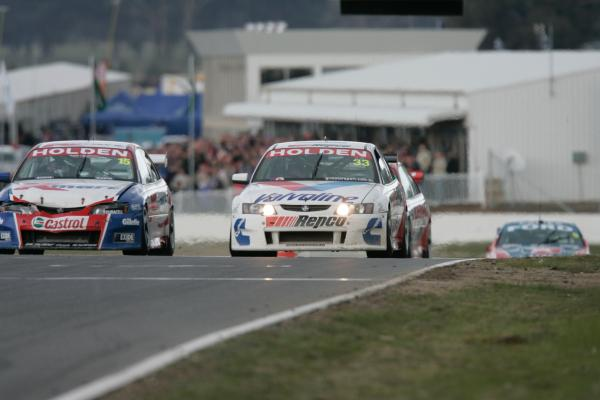 McConville (33) passing Rick Kelly (15) for the win at Winton