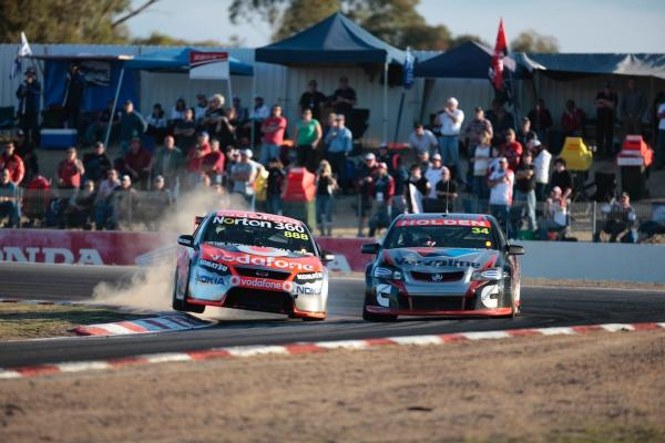 Lowndes and the Garry Rogers Motorsport Commodore of Michael Caruso, Winton 2009