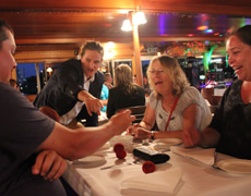 Roving magician on board Kookaburra Showboat Cruises