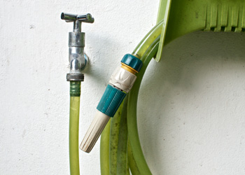 Hose Connected To Water Tap