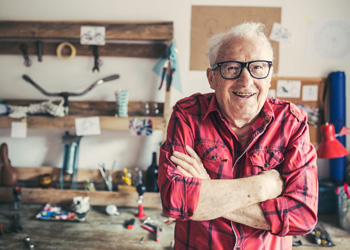 Elderly Gentleman In His Workshop