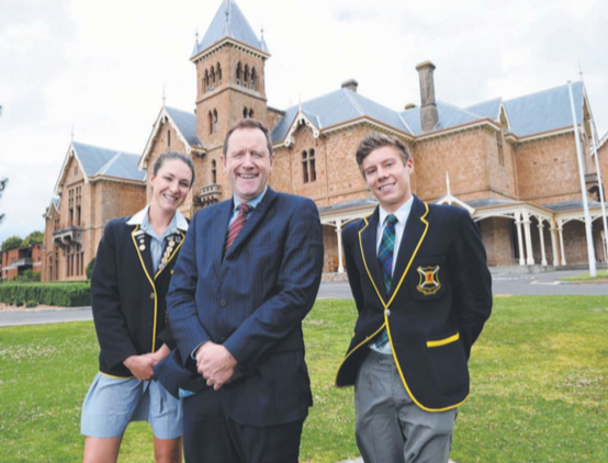 Scotch College principal designate Dr John Newton, with students Lizzie Treloar and David Spencer, believes single sex schools hinder careers.