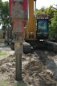 screw piling into sand