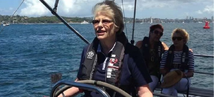 A photo of a lady -carer- sailing