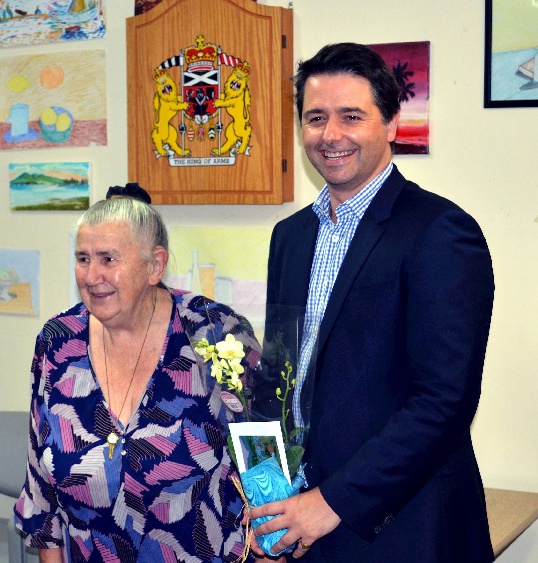 Alastair McEwin disability discrimination commissioner with an old lady