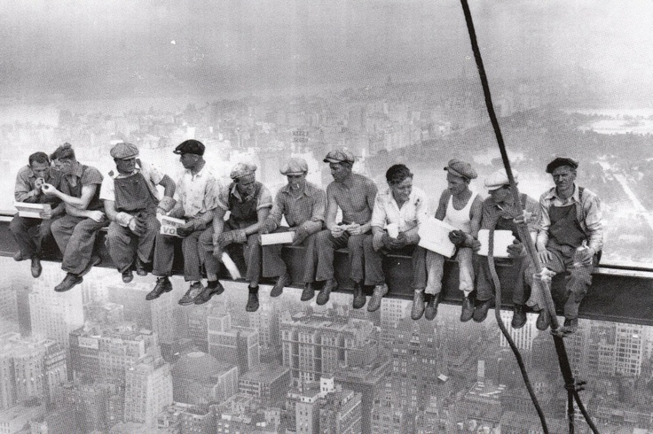 Black & white of steelworkers on skyscraper truss.