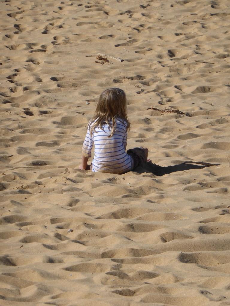 Immy sitting beach