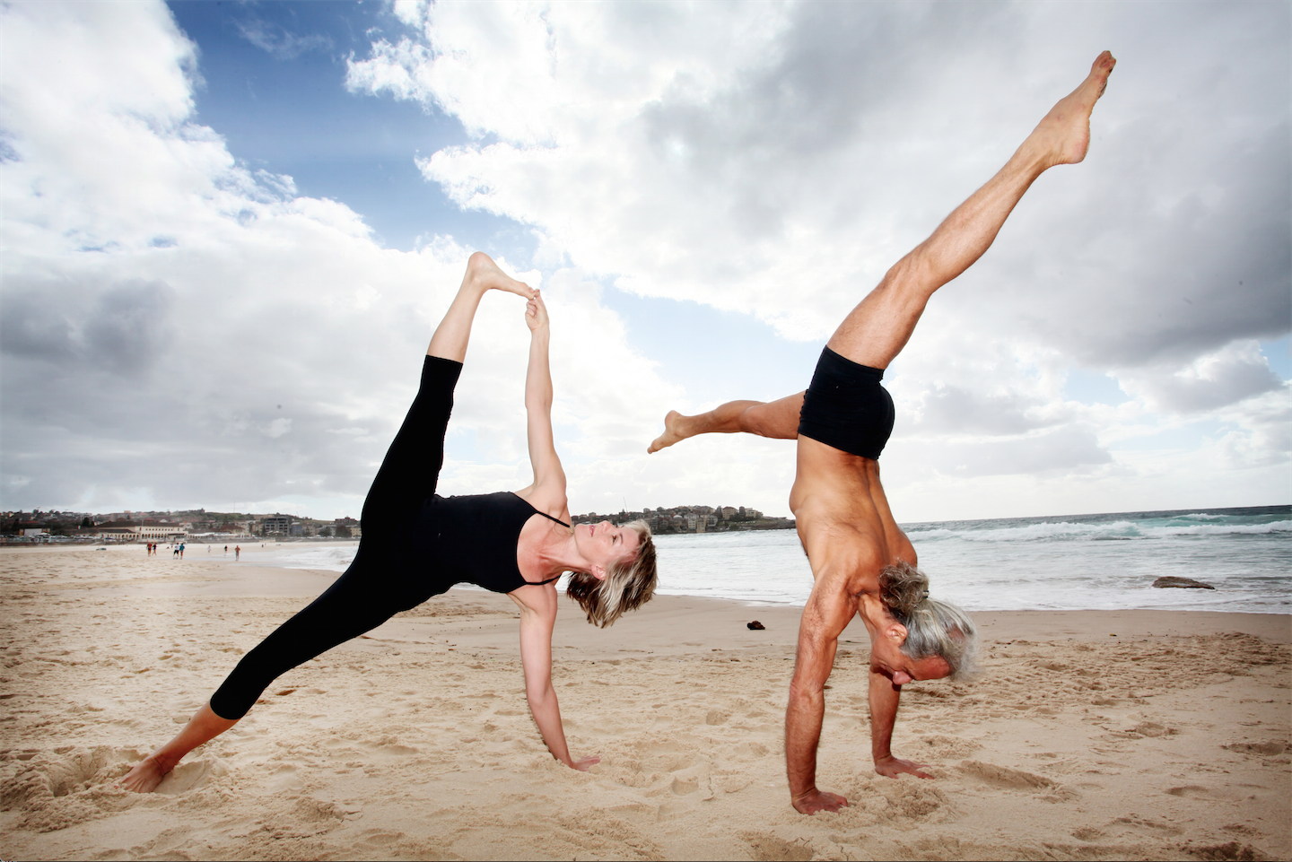 Bianca Machliss & Simon Borg-Olivier (Yoga Synergy) practicing together on Bondi Beach (photo courtesy Newspix)